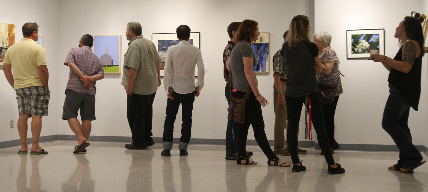 People looking at painting in gallery